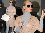 Iggy Azalea looks fresh as she touches down in Sydney. The international superstar seemed happy to be returning to her home country as she flashed her enormous sparkler on her ring finger.\n\nPictured: IGGY AZALEA\nRef: SPL1102074  170815  \nPicture by: madmax Pepito / Splash News\n\nSplash News and Pictures\nLos Angeles: 310-821-2666\nNew York: 212-619-2666\nLondon: 870-934-2666\nphotodesk@splashnews.com\n