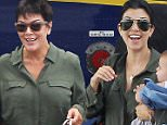 """Exclusive... 51825737 """"Keeping Up With the Kardashian"""" stars arrive on a small plane in St Barts on August 17, 2015. Pregnant Kim Kardashian was joined by her daughter North and sisters Kendall, Khloe and Kourtney, (along with her 3 children) as well as their mother Kris. Kourtney and Kris wore matching green jumpsuits. NO INTERNET USE WITHOUT PRIOR AGREEMENT FameFlynet, Inc - Beverly Hills, CA, USA - +1 (818) 307-4813"""