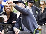 16.AUG.2015 - PARIS - FRANCE\n***EXCLUSIVE ALL ROUND PICTURES***\n*** STRICTLY NOT AVAILABLE FOR ONLINE****\n*AVAILABLE FOR UK SALE ONLY*\nAUSTRALIAN MODEL LARA BINGLE AND ACTOR BOYFRIEND SAM WORTHINGTON PICTURED ENJOYING A FAMILY HOLIDAY IN PARIS, THE HAPPY COUPLE ARE PICTURED SPENDING SOME QUALITY TIME WITH THEIR BABY SON TAKING SELFIES IN THE PARK BEFORE GOING SIGHTSEEING AROUND PARIS!\nBYLINE MUST READ : E-PRESS/ XPOSUREPHOTOS.COM\n***UK CLIENTS - PICTURES CONTAINING CHILDREN PLEASE PIXELATE FACE PRIOR TO PUBLICATION ***\n*THIS IMAGE IS STRICTLY FOR PAPER AND MAGAZINE USE ONLY - NO WEB ALLOWED USAGE UNLESS PREVIOUSLY AGREED. PLEASE TELEPHONE 0208 344 2007*