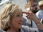 DES MOINES, IA - AUGUST 15:  Democratic presidential candidate Hillary Clinton eats a pork chop on a stick and carries a lemonade while greeting fairgoers at the Iowa State Fair on August 15, 2015 in Des Moines, Iowa. Presidential candidates are addressing attendees at the Iowa State Fair on the Des Moines Register Presidential Soapbox stage and touring the fairgrounds. The State Fair runs through August 23.  (Photo by Win McNamee/Getty Images)