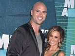 Arrivals at the 2015 CMT Music Awards held at Bridgestone Arena in Nashville, TN.....Pictured: Jana Kramer, Michael Caussin..Ref: SPL1050946  100615  ..Picture by: AdMedia / Splash News....Splash News and Pictures..Los Angeles: 310-821-2666..New York: 212-619-2666..London: 870-934-2666..photodesk@splashnews.com..