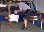 Anthony Joshua side planks with medicine ball repeatedly thrown at his core