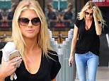 EXCLUSIVE TO INF. \nAugust 20, 2015: Charlotte McKinney has her hands full as she gets a sandwich and a drink to go while out in  Malibu, California.\nMandatory Credit: Lazic/Borisio/INFphoto.com Ref.: infusla-257/277