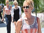 Melanie Griffith and Her Daughter Have Lunch at Cafe Zinque\n\nPictured: Melanie Griffith\nRef: SPL1105303  180815  \nPicture by: All Access Photo Group\n\nSplash News and Pictures\nLos Angeles: 310-821-2666\nNew York: 212-619-2666\nLondon: 870-934-2666\nphotodesk@splashnews.com\n