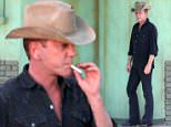 UK CLIENTS MUST CREDIT: AKM-GSI ONLY\nEXCLUSIVE: Mojave Desert, CA - Actor Kiefer Sutherland looks cool in a cowboy hat as he films a new country music video in the desert.  Kiefer puffed away on cigarettes  while filming a few scenes outside a makeshift diner.  Kiefer looked to be fighting the heat, grasping for air in-between takes.\n\nPictured: Kiefer Sutherland\nRef: SPL1104677  170815   EXCLUSIVE\nPicture by: AKM-GSI / Splash News\n\n