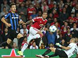 MANCHESTER, ENGLAND - AUGUST 18:  Memphis Depay of Manchester United in action with Dion Cools and Sebastien Bruzzese of Club Brugge during the UEFA Champions League play-off first leg match between Manchester United and Club Brugge at Old Trafford on August 18, 2015 in Manchester, England.  (Photo by Matthew Peters/Man Utd via Getty Images)