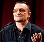 Bono, lead singer of U2, speaks at The Women's Conference, Wednesday, Oct. 22, 2008, in Long Beach, Calif. (AP Photo/Chris Pizzello)