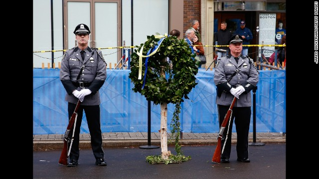 BOSTON, MA - APRIL 15:  Massachusetts state and local police and fire department members stand near the site of one of the bombs following a wreath-laying ceremony commemorating the one-year anniversary of the Boston Marathon bombings on Boylston Street near the finish line on April 15, 2014 in Boston, Massachusetts. Last year, two pressure cooker bombs killed three and injured an estimated 264 others during the Boston marathon, on April 15, 2013.  (Photo by Jared Wickerham/Getty Images)