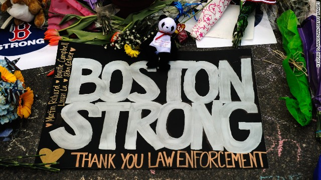 BOSTON, MA - APRIL 21: A large sign with the names of the Boston Marathon bombing victims and thanking law enforcement is placed by a Boston Bruins hockey team fan at a makeshift memorial for victims near the site of the bombings at the intersection of Boylston Street and Berkley Street two days after the second suspect was captured on April 21, 2013 in Boston,Massachusetts. A manhunt for Dzhokhar A. Tsarnaev, 19, a suspect in the Boston Marathon bombing ended after he was apprehended on a boat parked on a residential property in Watertown, Massachusetts. His brother Tamerlan Tsarnaev, 26, the other suspect, was shot and killed after a car chase and shootout with police. The bombing, on April 15 at the finish line of the marathon, killed three people and wounded at least 170. (Photo by Kevork Djansezian/Getty Images