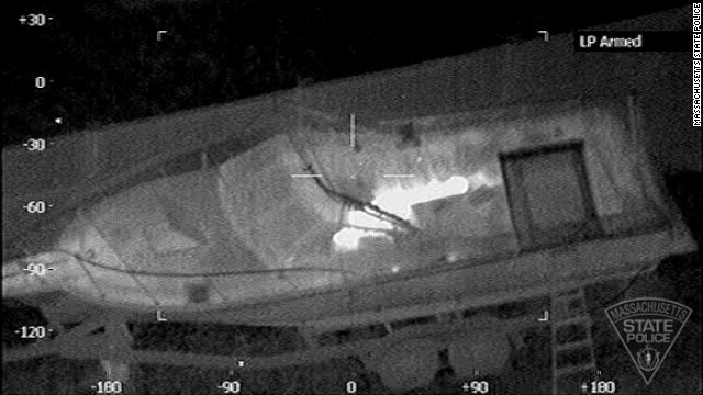 Special imaging techniques employed by Massachusetts State Police reveal Boston Marathon bombing suspect Dzhokar Tsarnaev hiding in the boat in a backyard of Watertown on April 19.