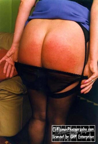 Katie bares her bottom for a spanking in the Kane Harrison Marks video A Punishing View