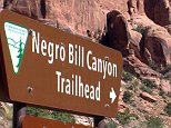 FILE - This undated photo shows a sign at the entrance of the Negro Bill Canyon Trailhead in Moab, Utah. The renewed national scrutiny of the Confederate flag has officials again considering changing the name of Utah's Negro Bill Canyon, though the title that some find offensive is a point of historical pride for others. (John Hollenhorst/The Deseret News via AP)  SALT LAKE TRIBUNE OUT; MAGS OUT; MANDATORY CREDIT