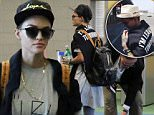 141443, Ruby Rose seen flying out of Vancouver International Airport. The DJ and 'Orange is The New Black' actress wore a 'I'm leaving tomorrow' sweater with a graphic tee, hat, silver toe sneakers, and black leather backpack. Vancouver, Canada - Friday August 21, 2015. Photograph: © Kred, PacificCoastNews. Los Angeles Office: +1 310.822.0419 sales@pacificcoastnews.com FEE MUST BE AGREED PRIOR TO USAGE