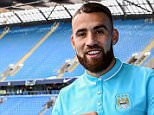 Manchester City's new signing Nicolas Otamendi poses at the Etihad Stadium with his number thirty shirt MINIMUM FEE 40GBP PER IMAGE - CONTACT PRESS ASSOCIATION IMAGES FOR FURTHER INFORMATION. Manchester City FC/Press Association Images.