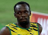 Jamaica's Usain Bolt, centre, races alongside United States' Mike Rodgers and Iran's Reza Ghasemi in round one of the men's 100m at the World Athletics Championships at the Bird's Nest stadium in Beijing, Saturday, Aug. 22, 2015. (AP Photo/Darron Cummings)