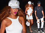 Rihanna and rumored Boyfriend Lewis Hamilton were spotted arriving Simultaneously to Griffin Nightclub in NYC Friday night. Lewis Arrived to the club at the same time that Rihanna did, in Two dark SUVs. He hid his face inside the backseat of his car, while he waited for Rihanna to walk into the club. She wore all white , with a white baseball cap, while he opted for black, with ripped jeans.   Pictured: Rihanna, Lewis Hamilton Ref: SPL1102465  140815   Picture by: 247PAPS.TV / Splash News  Splash News and Pictures Los Angeles: 310-821-2666 New York: 212-619-2666 London: 870-934-2666 photodesk@splashnews.com