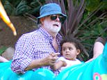 EXCLUSIVE: George Lucas rides the Heimlich ChooChoo train at Disney California Adventure with his daughter Everest   Pictured: George Lucas and Everest Hobson Lucas Ref: SPL1105607  200815   EXCLUSIVE Picture by: not fern /  Splash News  Splash News and Pictures Los Angeles: 310-821-2666 New York: 212-619-2666 London: 870-934-2666 photodesk@splashnews.com