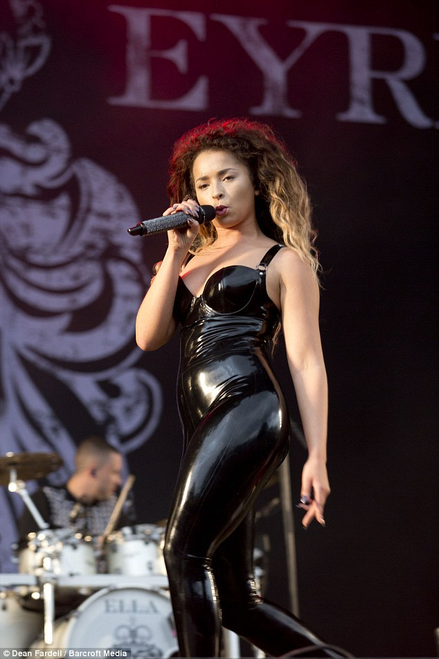 Risque: The 21-year-old highlighted her stunning figure in a raunchy latex catsuit which featured a daring plunging neckline