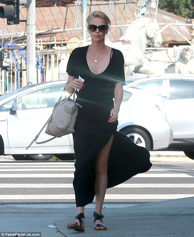 Elegant: Charlize Theron looked stunning after lunch at Sugarfish in Los Angeles on Friday
