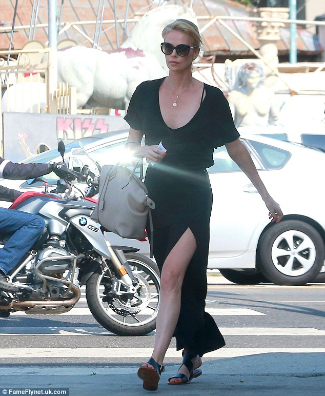 Leggy lady: The 40-year-old actress showed off her long legs in a low-cut black dress slashed to the thigh