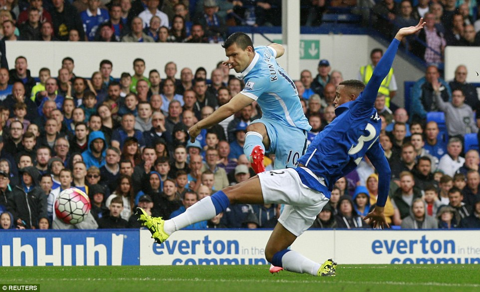 Sergio Aguero shoots under pressure from Everton's 19-year-old defender Brendan Galloway before his day is cut short though injury