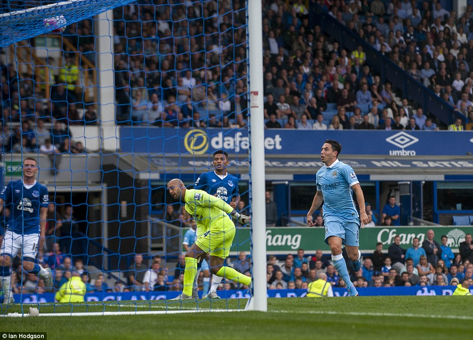 Nasri has an anxious moment as he waits for his shot to sneak under the crossbar before City's celebrations could commence