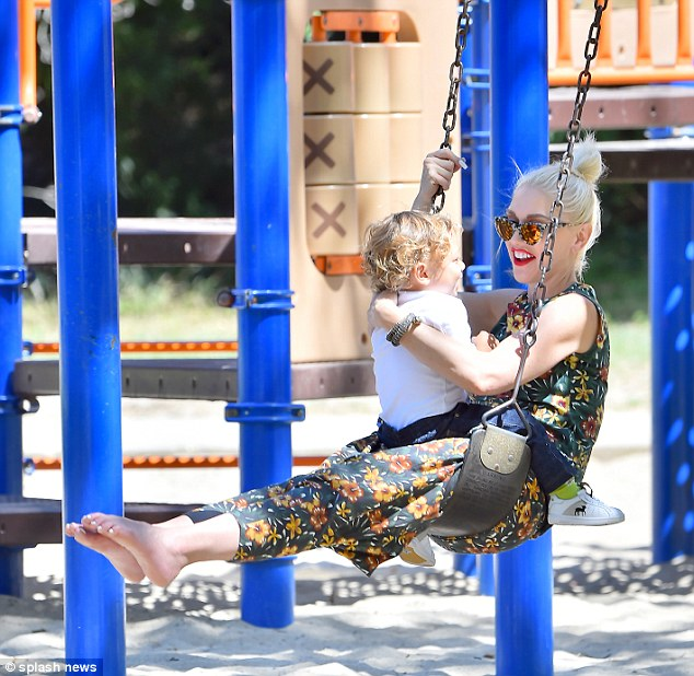 Mommy and me! Gwen Stefani seemed to be having a blast as she played on the swings with youngest son Apollo on Sunday