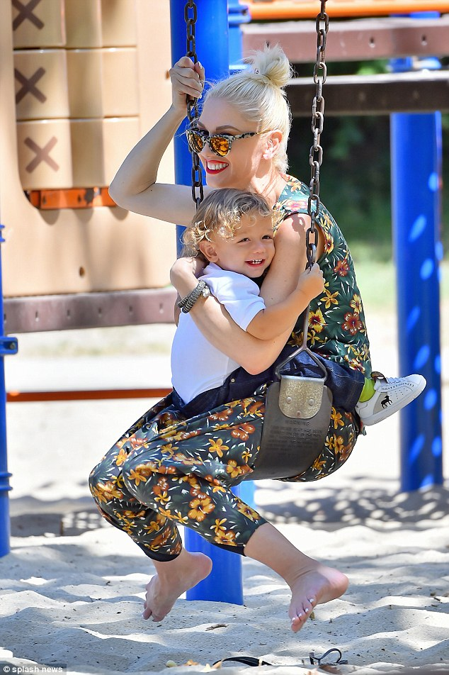 Smile on her dial: THe 17-month-old seemed to be cheering up his mother after her difficult split with Gavin Rossdale