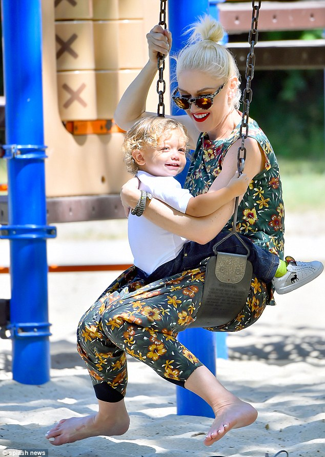 Tender: The duo shared a sweet moment on the swings together