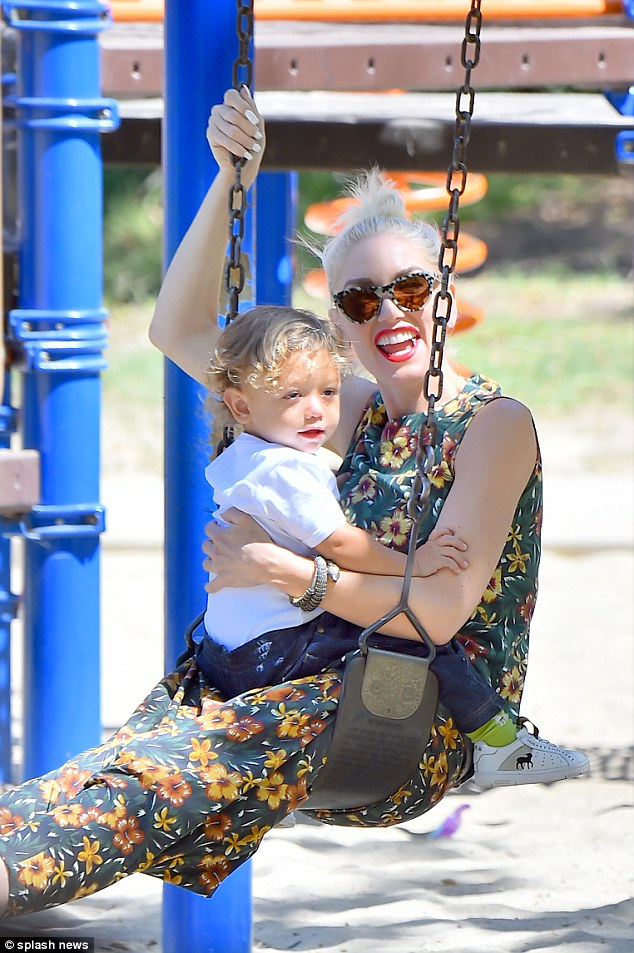 Having a blast: Gwen couldn't hide her smile as she spent time with youngest song Apollo on Sunday