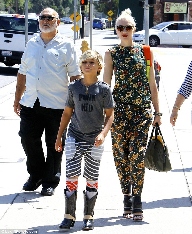 Seeking solace: Earlier on Sunday Gwen visited church in Universal City, California with her three sons and her parents