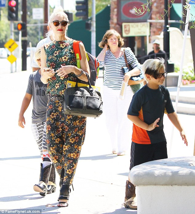 Gang's all here: Gwen was joined on the outing by herparents Dennis Stefani and Patti Flynn
