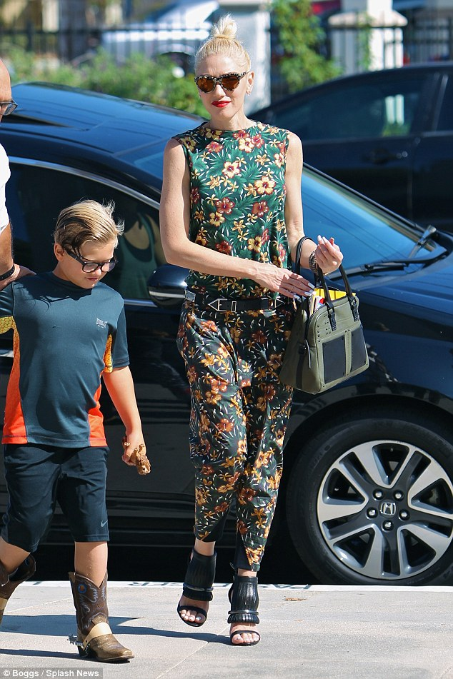 Looking trim: Gwen showed off her slim figure in the chic jumpsuit, which she wore cinched with a black leather belt
