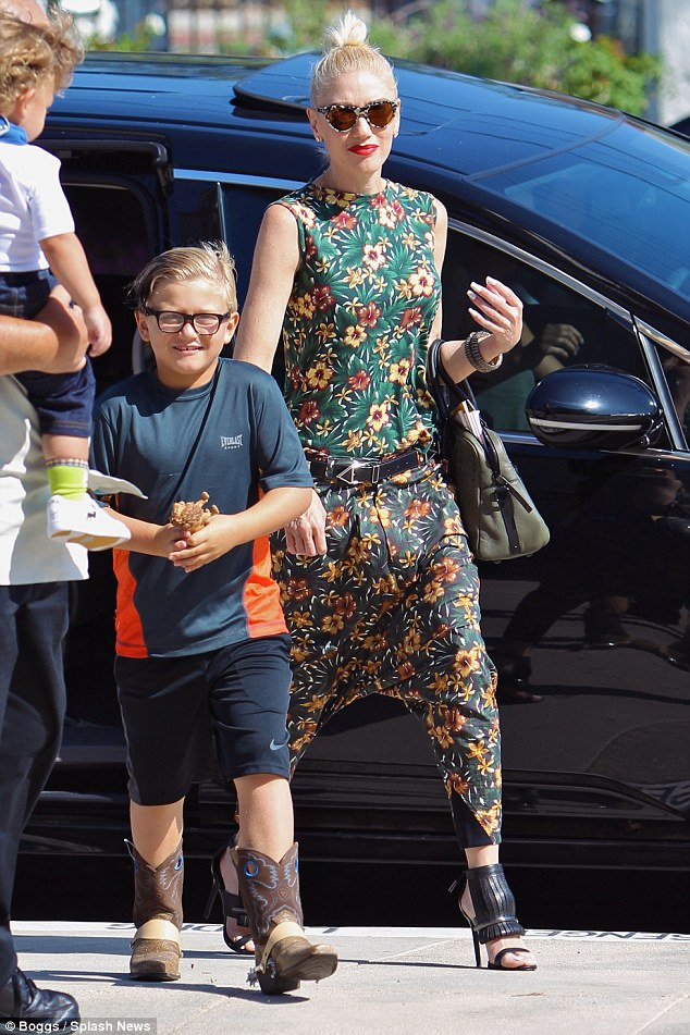 Showing off his style: Gwen's six-year-old son Zuma sported a blue and orange athletic shirt, black Nike shorts, and a pair of brown cowboy boots with light blue detailing