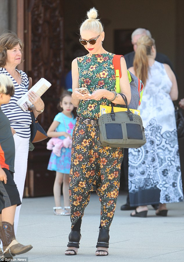 Eye-catching: Gwen likely stood out from the crowd in her chic floral jumpsuit and killer high heels