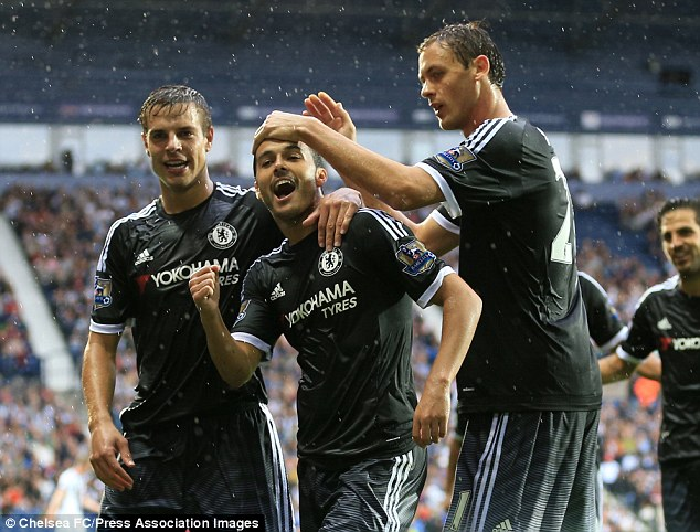 Pedro (centre) celebrates with his Chelsea team-mates as he put his team into the lead on his debut