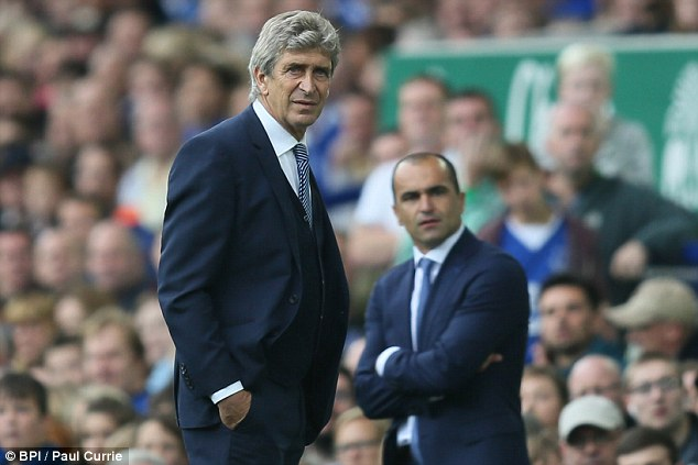 City boss Manuel Pellegrini (left) warned title rivals that his side will only improve this season