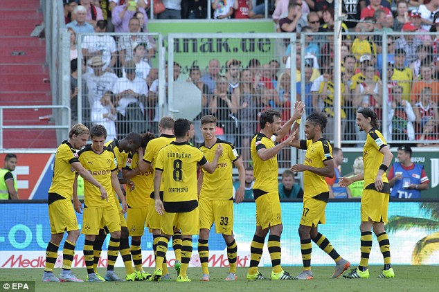 Borussia Dortmund thrashed newly-promoted Ingolstadt 4-0 to go top of the Bundesliga on goal difference