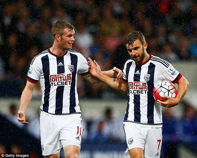 James Morrison (right) pushes Chris Brunt away in order to take the penalty kick against Chelsea