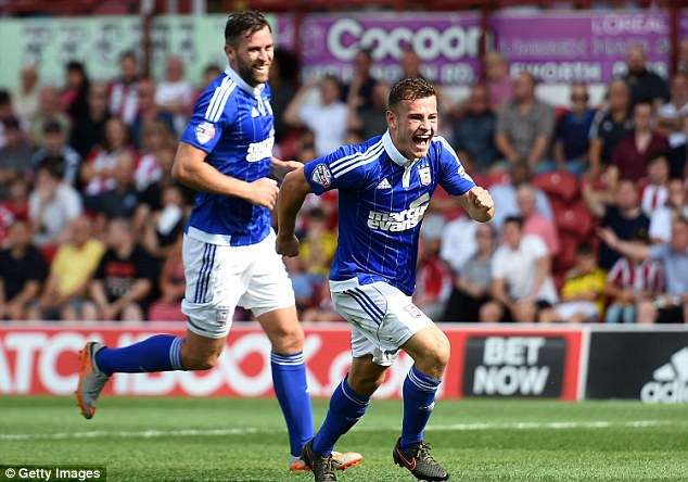 Ipswich'sRyan Fraser (right) celebrates scoring against Brentford at Griffin Park in the match on August 8