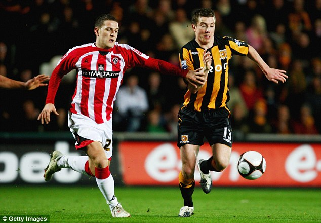 Sheffield United's Billy Sharp (left) tracks the run of Hull's Ryan France in the FA Cup match in 2009