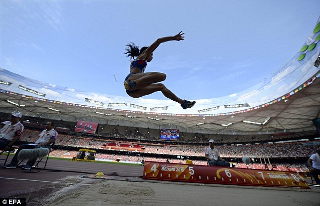 The Brit launches into the air during the long jump event of the Heptathlon in the Bird's Nest Arena
