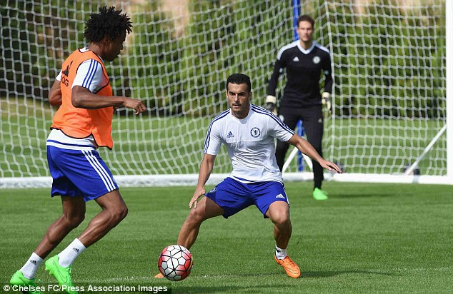 Pedro joins in a training session with his new-teammates following his move from Barcelona to Chelsea