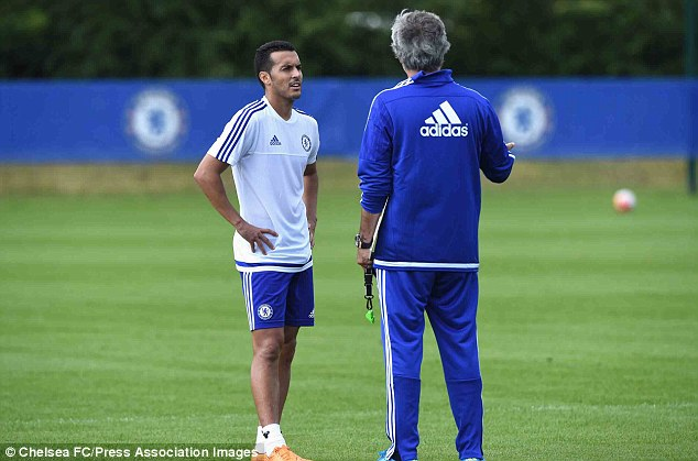 Pedro speaks with new manager Jose Mourinho following his £21m arrival at Stamford Bridge this week