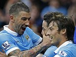 Kolarov (left) is ecstatic after Frenchman Nasri (centre with David Silva) added to his earlier strike for another sky blues victory