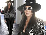 """Cher shows why she's still a fashion icon as she catches a flight out of Los Angeles as the 50th anniversary for her hit song, """"I Got You Babe"""" nears.  Cher was seen in a black and white outfit with a stylish hat as she caught a flight out of LAX.\n\nPictured: Cher\nRef: SPL1107683  230815  \nPicture by: Sharky / Splash News\n\nSplash News and Pictures\nLos Angeles: 310-821-2666\nNew York: 212-619-2666\nLondon: 870-934-2666\nphotodesk@splashnews.com\n"""