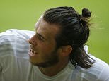 Real Madrid's Gareth Bale reacts during a Spanish La Liga soccer match between Real Madrid and Sporting de Gijon at the 'El Molinon' stadium in Gijon, Spain, Sunday, Aug. 23, 2015. (AP Photo/Jose Vicente)