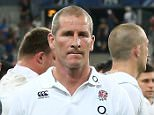 PARIS, FRANCE - AUGUST 22:  Stuart Lancaster, (C) the England head coach looks dejected as he leads his team off the pitch after their defeat during the International match between France and England at Stade de France on August 22, 2015 in Paris, France.  (Photo by David Rogers/Getty Images)