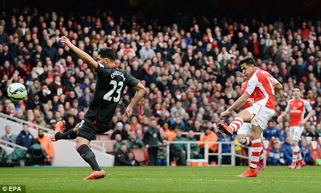 Arsenal forward Alexis Sanchez puts the Gunners 3-0 up against Liverpool at the Emirates on Saturday
