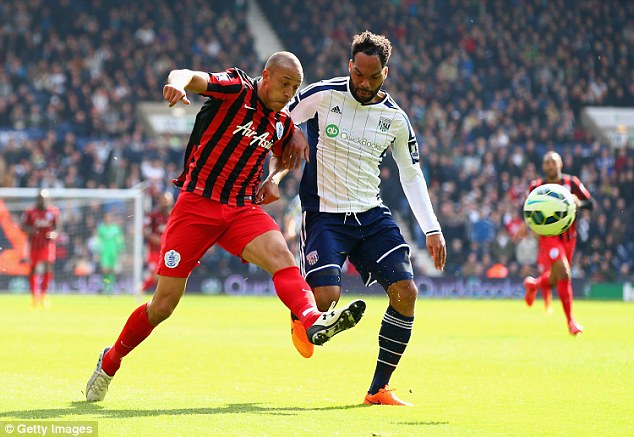 QPR's Bobby Zamora (left) gets in front of Joleon Lescott to score his side's third goal against West Brom